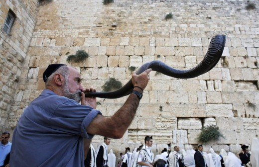 Jewish worshipper blows shofar at Western Wall
