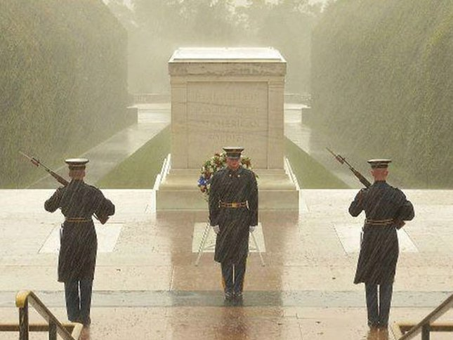 Soldiers in the rain guarding the Tomb of the Unknown Soldier