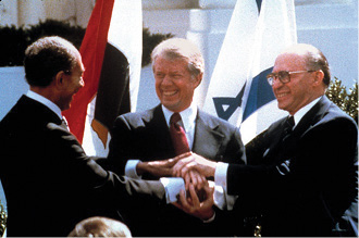 U.S. president Jimmy Carter, Egyptian President Anwar El Sadat, and Israeli Prime Minister Menachem Begin