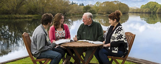 Chuck giving a Bible study by the river